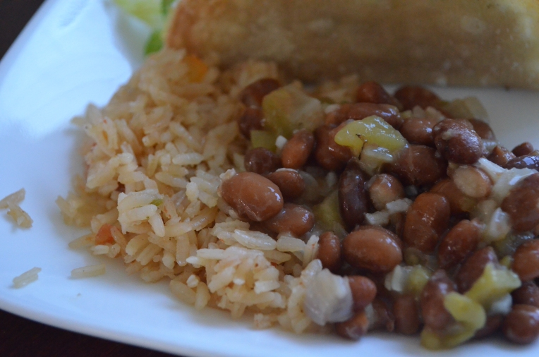 spicy beans and mexican rice on a plate